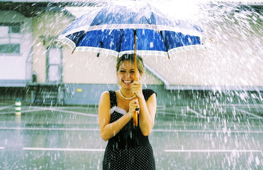 Woman Under Umbrella Raining