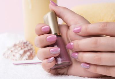 Woman holding nail polish spring mani