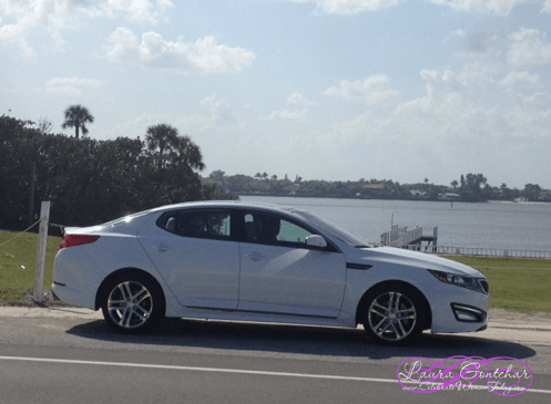 KIA Optima crusing along coast