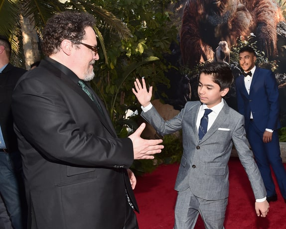Hi-Five from Neel Sethi (Mowgli) to Director Jon Favreau during the Red Carpet World Premiere of The Jungle Book. El Capitan, Hollywood, April 4, 2016 Photo by Alberto E. Rodriguez/Getty Images for Disney)