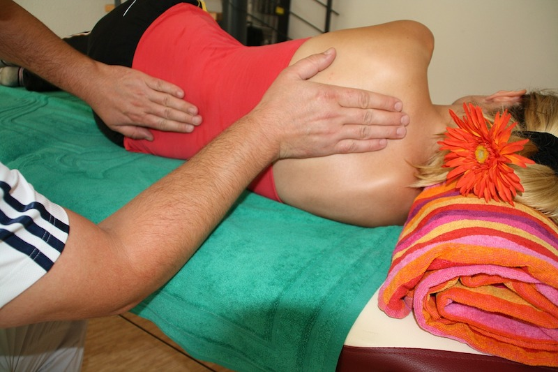Lower back pain relief with therapeutic massage in addition to DR. HO'S decompression belt.
