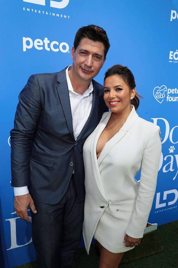 Ken Marino, Director, and Eva Longoria take a quick stop in front of cameras during the DOG DAYS Red Carpet Movie Premiere