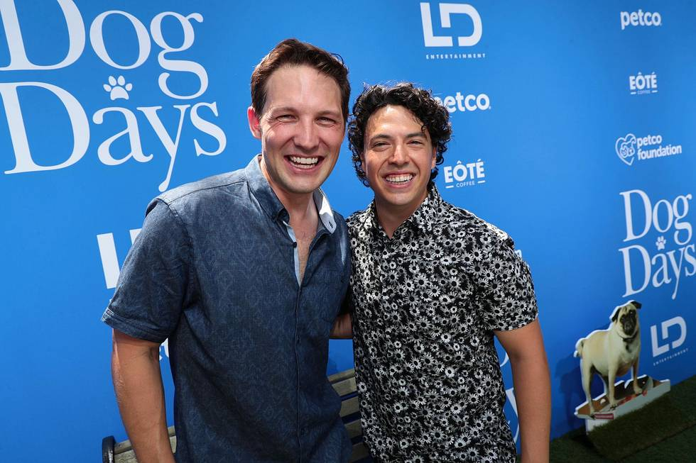 Michael Cassidy and Jon Bass posing in front of camera DOG DAYS Red Carpet Movie Premiere August 5, 2018, Los Angeles