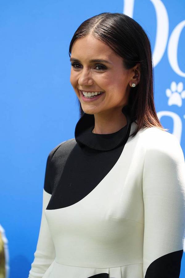 Actress Nina Dobrev wore a very interesting dress to the Red Carpet of DOG DAYS Movie Premiere