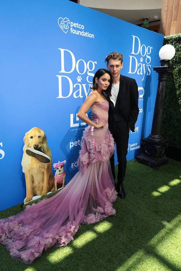 Vanessa Hudgens plays Tara, a coffee shop barista, in the movie DOG DAYS. In this picture with the guest during DOG DAYS Red Carpet Movie Premiere