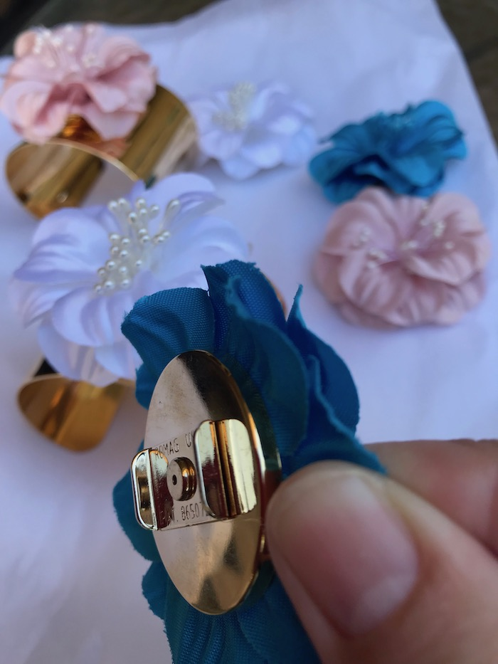 Costume jewelry for women can be so beautiful and affordable. These gold-plated bangles by Dress for Cocktails have many colors interchangeable flowers. Change the flowers as you change your occasion!