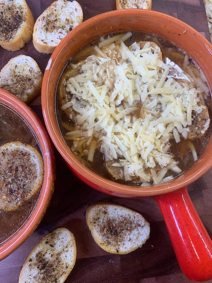 A classic French Onion Soup recipe prepared in the crockpot and loaded with incredible flavor, caramelized onions, and Gruyère cheese. What a celebration of flavors for a family meal! #slowcooker #recipes #easysoup #soup #frenchonionsoup #souprecipe #easymeal #maincourse #easylunch #onionsoup #easyrecipe