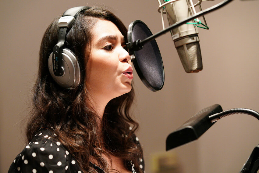 Auli'i Cravalho singing in the studio